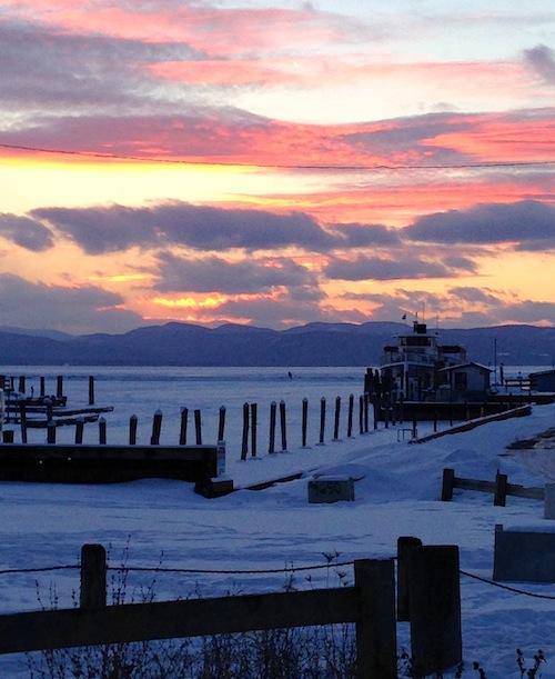 sunset over frozen lake